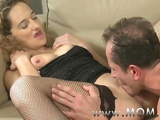 Mommy nasty curly haired cougar getting pummeled on the couch porn video