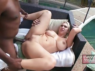 Good-looking busty latin harlot performing in an interracial porn video in the open